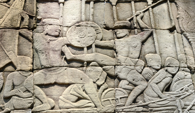Wall engravings of people practising bokator at the Bayon temple part of the Angkor temples complex